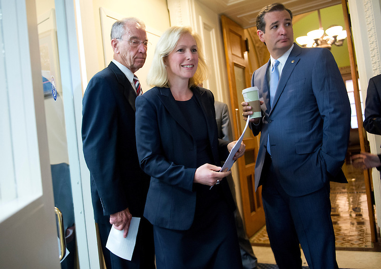 UNITED STATES - JULY 16: Sens. Kirsten Gillibrand, D-N.Y., Ted Cruz, R-Texas, right, and Charles Grassley, R-Iowa, prepare for a news conference in the Capitol on legislation that would create a new process for reviewing cases of military sexual assault and alleviate victims' fear of reporting an incident. (Photo By Tom Williams/CQ Roll Call)