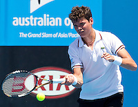 MILOS RAONIC (CAN) against FILIPPO VOLANDRI (ITA) in the first round of the Men's Singles. Milos Raonic beat Filippo Volandri 6-4 6-0 6-2 ..17/01/2012, 17th January 2012, 17.01.2012..The Australian Open, Melbourne Park, Melbourne,Victoria, Australia.@AMN IMAGES, Frey, Advantage Media Network, 30, Cleveland Street, London, W1T 4JD .Tel - +44 208 947 0100..email - mfrey@advantagemedianet.com..www.amnimages.photoshelter.com.