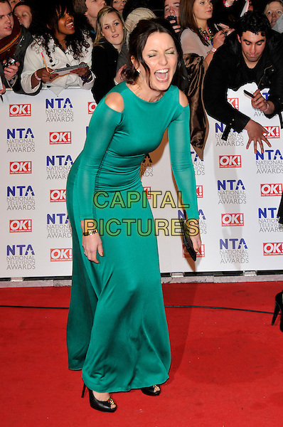 DAVINA McCALL .Attending the National Television Awards at O2 Arena, London, England..January 26th, 2011.arrivals NTA NTAs full length green cut out dress away shoulders side long sleeve maxi black peep toe shoes funny bending leaning mouth open laughing  .CAP/PL.©Phil Loftus/Capital Pictures.