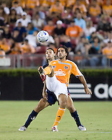 Houston Dynamo midfielder Dwayne De Rosario (14) shields the ball from Atlante FC defender Andres Carevic (20).  Houston Dynamo defeated Atlante FC 4-0 during the group stage of the Superliga 2008 tournament at Robertson Stadium in Houston, TX on July 12, 2008.