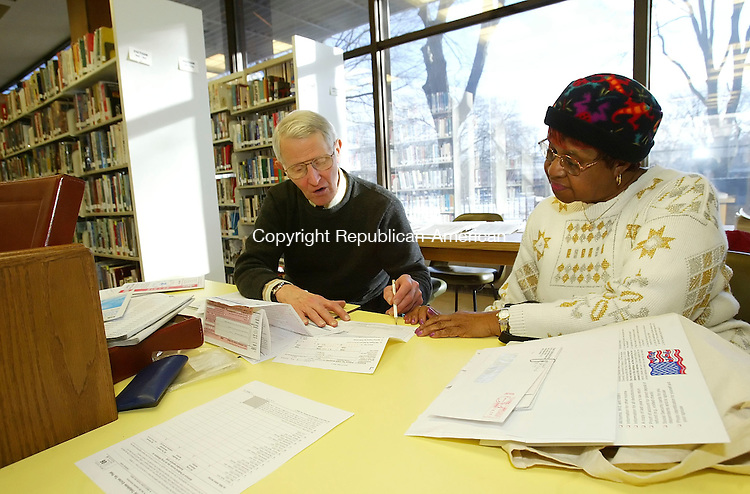 WATERBURY, CT, 03/07/07- 030707BZ05-  John Staver, of Watertown, of Volunteers Income Tax Assistance (VITA), helps Gladys Passmore, of Waterbury, prepare her income tax returns at the Silas Bronson Library in Waterbury Wednesday afternoon.  According to the IRS Website, VITA volunteers are certified to help prepare basic tax returns in communities across the country.  The VITA program at the Silas Bronson Library is held between 3 p.m. and 7 p.m. on Wednesday's.  Staver said an average of 25 people show up each week for the free help even though he is only able to service 10 to 12 daily. &quot;One day I had 37 people lined up,&quot; he said.  In addition to VITA  the AARP also offers free tax preparation at the Library on Tuesday's and Wednesday's between the hours of 10 a.m. and 1 p.m.  Both programs continue through April 11, 2007.<br /> Jamison C. Bazinet Republican-American