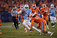 Charlotte, NC - December 5, 2015: QB Marquise Williams, #12 of the North Carolina Tar Heels, runs the ball in the ACC Football Championship game between the North Carolina Tar Heels and the Clemson Tigers at the Bank of America Stadium in Charlotte, North Carolina, December 5, 2015. Clemson defeated North Carolina 45-37.  (Photo by Don Baxter/Media Images International)