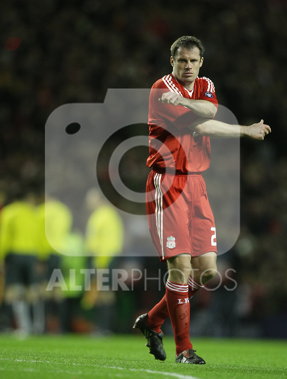 Jamie Carragher stretches during the Champions League Round of 16, Second Leg match between Liverpool and Real Madrid at Anfield on March 10, 2009 in Liverpool, England