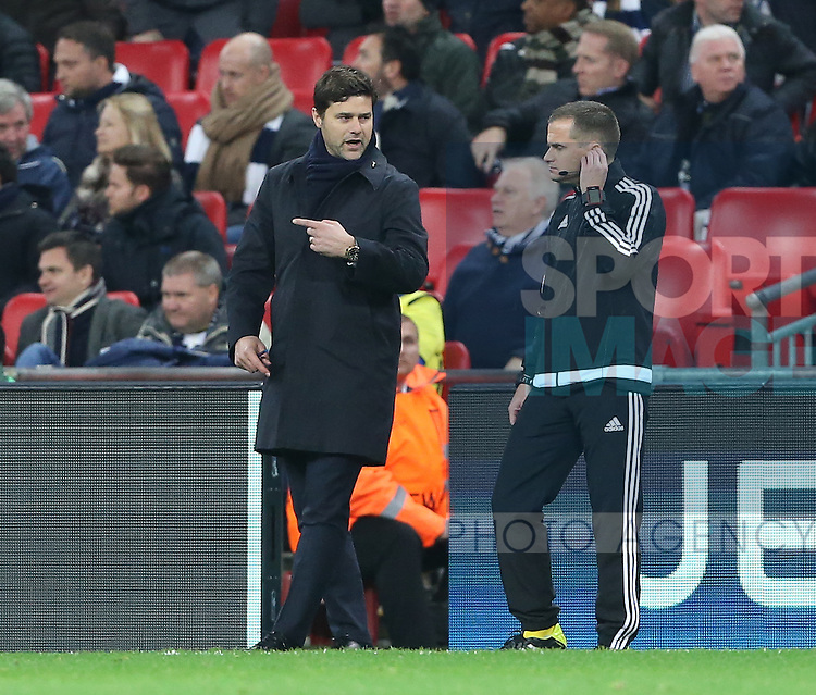 Tottenham's Mauricio Pochettino has words with the fourth official after a foul on Dele Alli during the Champions League group E match at the Wembley Stadium, London. Picture date November 2nd, 2016 Pic David Klein/Sportimage