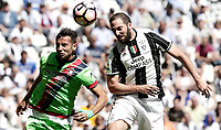 Calcio, Serie A: Juventus vs Crotone. Torino, Juventus Stadium, 21 maggio 2017.<br /> Crotone's Gian Marco Ferrari, left, and Juventus' Gonzalo Higuain jump for the ball during the Italian Serie A football match between Juventus and Crotone at Turin's Juventus Stadium, 21 May 2017. Juventus defeated Crotone 3-0 to win the sixth consecutive Scudetto.<br /> UPDATE IMAGES PRESS/Isabella Bonotto