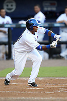 St. Lucie Mets outfielder Cesar Puello #21 bunts during a game against the Charlotte Stone Crabs at Digital Domain Ballpark on June 20, 2011 in Port St Lucie, Florida.  St. Lucie defeated Charlotte 3-2 in 11 innings.  (Mike Janes/Four Seam Images)