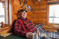 Portrait of pilot Art Mortvedt in his remote cabin.