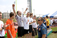 Exuberant athlete wearing 1st place medal. Special Olympics U of M Bierman Athletic Complex. Minneapolis Minnesota USA