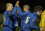 Airbus UK 4 Bangor City 1, 12/01/2007. The Airfield, Welsh Premier League. Home striker Darren Williams (centre) celebrates scoring the opening goal as lowly Airbus UK (blue) take on Bangor City in a Welsh Premier League match at The Airfield, Broughton. The Airmen won by 4 goals to 1, having lead by a solitary goal at the break in this North Wales clash. Photo by Colin McPherson.