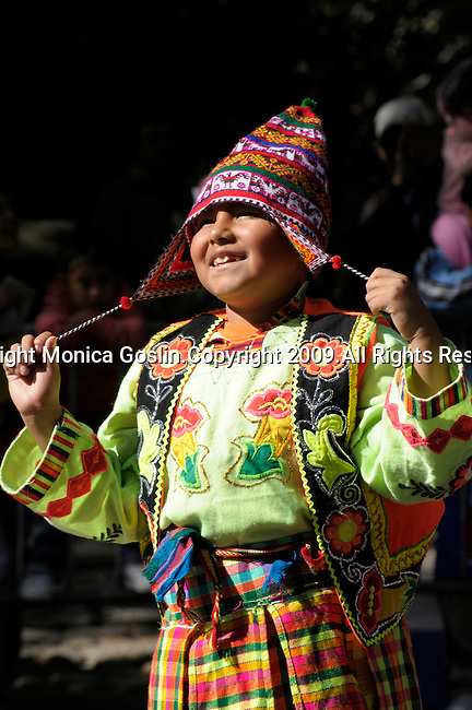 The Hispanic Parade in New York City. A boy wearing traditional clothes and representing Bolivia smiles during the Hispanic Parade in New York City.