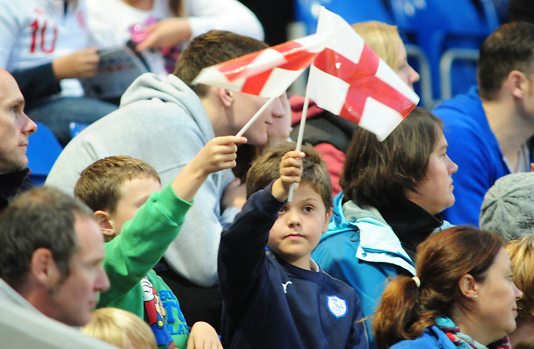 Young England fans wave flags while they watch the game..International Football - European U-21 Championship Group Eight - England U21 v Norway U21 - Monday 10th September 2012 - Proact Stadium - Chesterfield..