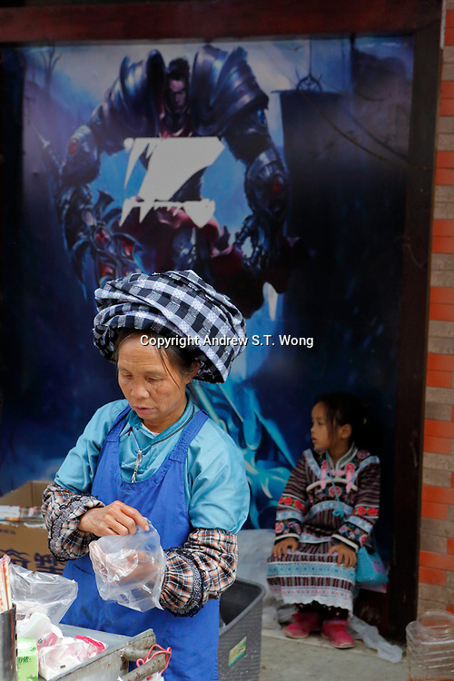 A vendor the ethnic Bouyei Tribe sells traditional food at Wangmo County in China's southwestern Guizhou Province, April 2019.