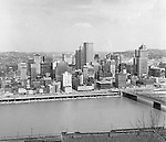 Pittsburgh PA:  View of the city's skyline - 1962.  View includes the Grant, William Penn Place, and Gulf Buildings, and the construction of the Blue Cross Building on Smithfield and Fort Pitt Boulevard.