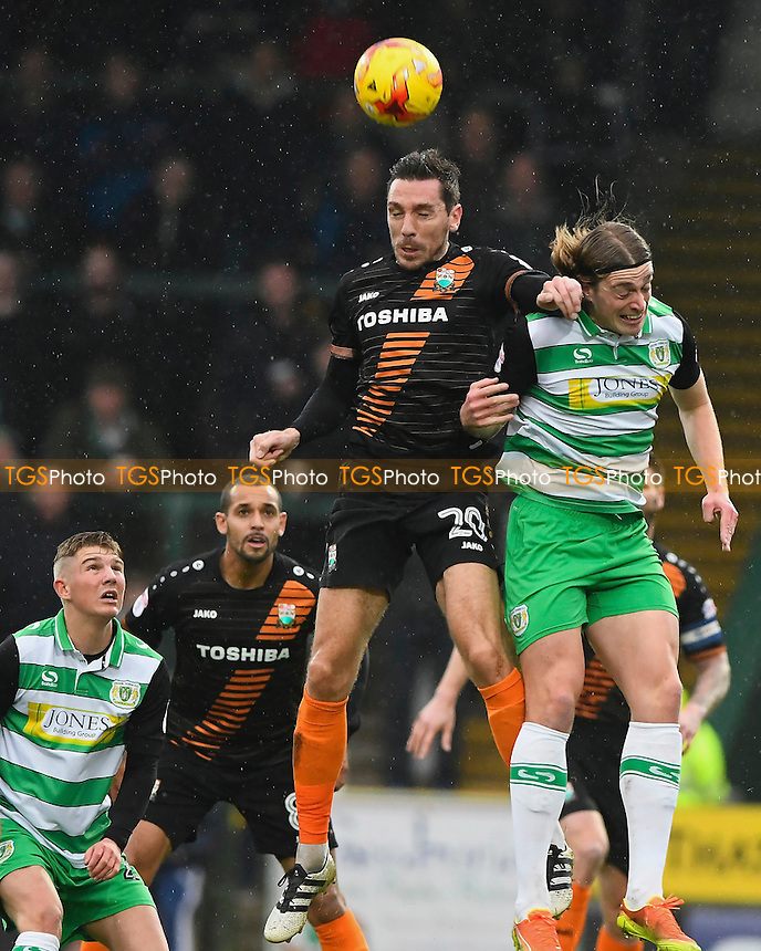 Tom Champion of Barnet wins a header  from Tom Eaves of Yeovil Town during Yeovil Town vs Barnet, Sky Bet EFL League 2 Football at Huish Park on 10th December 2016