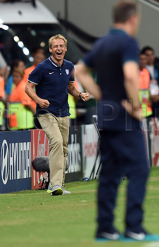 22.06.2014. Manaus, Brazil. Head coach Juergen Klinsmann of USA celebrates as his team goes ahead 2-1 during the FIFA World Cup 2014 group G preliminary round match between the USA and Portugal at the Arena Amazonia Stadium in Manaus, Brazil, 22 June 2014.