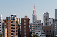 The distinctive NTT Docomo Tower behind apartment buildings in Tokyo, Tokyo, Japan. Friday July 10th 2015