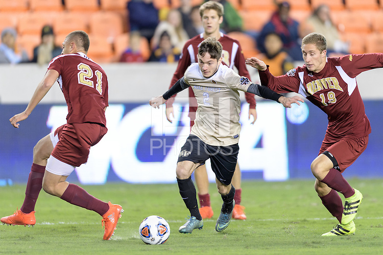 Houston, TX - Friday December 9, 2016: Luis Argudo (2) of the Wake Forest Demon Deacons and AJ Fuller (19) of the Denver Pioneers race for a loose ball at the NCAA Men's Soccer Semifinals at BBVA Compass Stadium in Houston Texas.