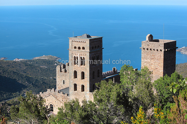 Towers of the Sant Pere de Rodes, a Benedictine monastery on the Verdera mountain in the Sierra de Rodes, overlooking the Mediterranean Sea on the Costa Brava, Puerto de la Selva, Girona, Catalonia, Spain. The monastery was founded in 945 by monks who escaped Barbarian invasions with relics of saints, and was eventually sacked in the 17th century and deserted in the 18th century. The Romanesque church was founded in 1022, also notable are the 12th century bell tower and cloisters. Picture by Manuel Cohen