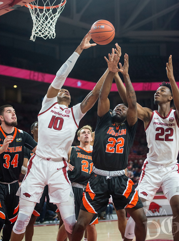 NWA Democrat-Gazette/BEN GOFF @NWABENGOFF <br /> Daniel Gafford (10) and Gabe Osabuohien of Arkansas reach for a rebound vs Dillon Nash of Tusculum in the second half Friday, Oct. 26, 2018, during an exhibition game in Bud Walton Arena in Fayetteville.