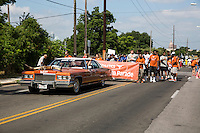 "AUSTIN, TEXAS - A vintage cadillac painted in ""burnt orange"" with longhorns mounted on the hood drives along the University of Texas Athletics Department at the 2016 Central Texas Juneteenth Celebration Parade on on Sat. June 18, 2016. <br />