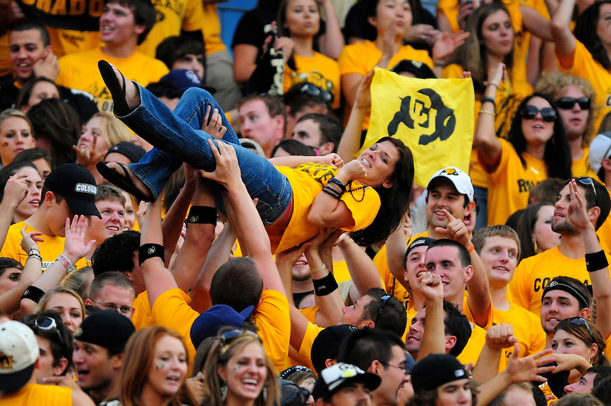 31 Aug 2008: A Colorado fan is hoisted in the air after a Buffaloes touchdown during a game against Colorado State. The Colorado Buffaloes defeated the Colorado State Rams 38-17 at Invesco Field at Mile High in Denver, Colorado. FOR EDITORIAL USE ONLY