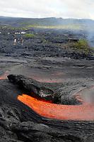 People watching large lava surface flow by hwy 130, Near Hawaii, USA Volcanoes National Park, Kalapana, Hawaii, USA, The Big Island of Hawaii, USA