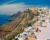 GREECE, Santorini, Fira, the cliffs of Santorini tattered with homes and restaurants