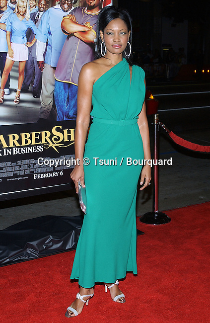 Garcelle Beauvais arriving at the BarberShop2 Back In Business Premiere at the Chinese Theatre in Los Angeles. January 20, 2004.