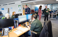 19/03/2020 - Picture released by Kensington Palace of Prince William Duke of Cambridge and Kate Duchess of Cambridge talks with the Chief Executive of the London Ambulance Service, Garrett Emmerson during a visit to the London Ambulance Service 111 control room in Croydon on Thursday to meet ambulance staff and 111 call handlers who have been taking NHS 111 calls from the public, and thank them for the vital work they are doing. Photo Credit: ALPR/AdMedia