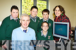 Students from Killarney Monastry NS who presented a cheque of EUR3,367 which they raised by holding a sponsor-shipped walk to their Principal Colm O'Suilleabhain at the school on Tuesday, the money will be used to buy white Boards and computer equipment l-r:  Anthony Battles, Colm O'Suilleabhain, Derek Szwab, Michael Jaz, Shane Griffin and Audrey O'Leary Parents Association