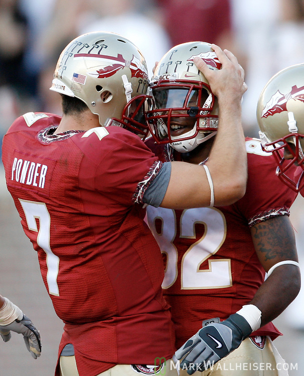 FSU quarterback Christian Ponder (7) celebrates with Taiwan Easterling  after his touchdown in the second half of the Florida State Seminoles' 30-20 defeat of the Virginia Tech Hokies on Bobby Bowden Field  in Tallahassee, Florida October 25, 2008.  (Mark Wallheiser/TallahasseeStock.com)