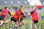 No way through for Listowel Emmets Conor Cox(12) against Danny Wrenn(5) and Jason Wrenn(7) of Tarbert in the North Kerry Senior Football Final held last Sunday in Bob Stack Park, Ballybunion.