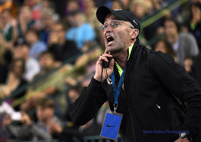 Alberto Salazar yells out to Mo Farah of Great Britain as he  runs in the Men's 10000 meter run on the opening day of the Prefontaine Classic at Hayward Field in Eugene, Oregon, USA, 29 MAY 2015. (EPA Photo by Steve Dykes)