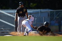 Jonah Davis (14) of the Bristol Pirates is tagged out by Danville Braves third baseman Brendan Venter (56) as Miguel Perez (28) looks on at American Legion Post 325 Field on July 1, 2018 in Danville, Virginia. The Braves defeated the Pirates 3-2 in 10 innings. (Brian Westerholt/Four Seam Images)