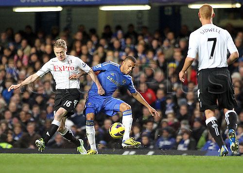 28.11.2012.  London, England. Fulham's Damien Duff and Chelsea's Ryan Bertrand in action during the Barclays Premier League game between Chelsea and Fulham at Stamford Bridge