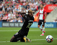 Tammy Abraham of Swansea City sits dejected on the ground after heading the ball wide during the Premier League match between Southampton and Swansea City at the St Mary's Stadium, Southampton, England, UK. Saturday 12 August 2017