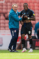 27th June 2020; Bet365 Stadium, Stoke, Staffordshire, England; English Championship Football, Stoke City versus Middlesbrough; New Middlesborough Manager Neil Warnock celebrates the win after the game with Britt Assombalonga