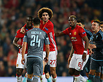 Facundo Roncaglia of Celta Vigo squares top to Eric Bailly of Manchester United during the Europa League Semi Final 2nd Leg match at Old Trafford Stadium, Manchester. Picture date: May 11th 2017. Pic credit should read: Simon Bellis/Sportimage