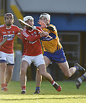 Luke Meade of Cork  in action against Ryan Taylor of Clare during their Munster Hurling League game at Cusack Park. Photograph by John Kelly.