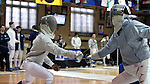 11 February 2017: UNC's Theophilus Onigbinde (left) scores a hit on Duke's Pascual Di Tella (ARG) (right) during Saber. The Duke University Blue Devils hosted the University of North Carolina Tar Heels at Card Gym in Durham, North Carolina in a 2017 College Men's Fencing match. Duke won the dual match 19-8 overall, 6-3 Foil, 6-3 Epee, and 7-2 Saber.