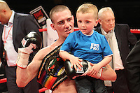Kevin Satchell (blue shorts) vs Paul Edwards in a boxing contest for the vacant Commonwealth (British Empire) flyweight titleat the Aintree Equestrian Centre 19-05-12