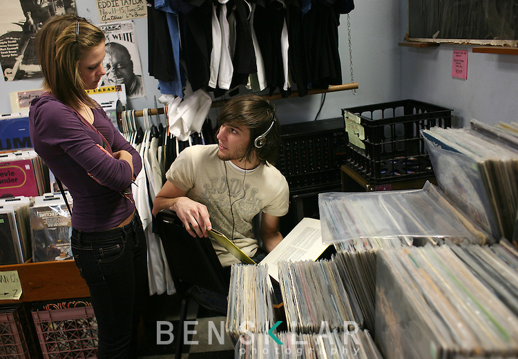 Hilary Holmes and Coulter Gibson shop for vinyl records at Antone's record shop in Austin, Texas. Austin hosts the South by Southwest Music Festival and is home to notable record stores that continue to stock, buy and sell vinyl records enriching its homegrown music scene.  (Photo by Ben Sklar for the New York Times)
