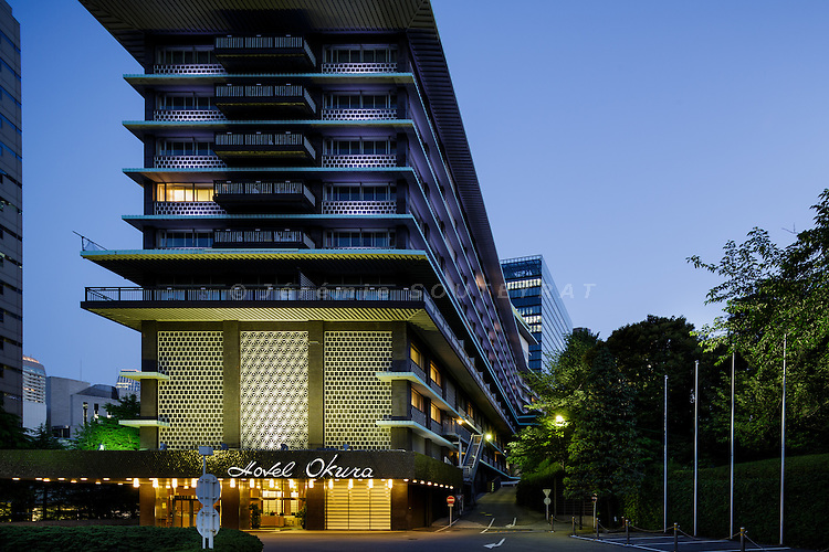 Tokyo, June 4 2015 - Main wing by night of Hotel Okura, built in 1962 under the design direction of Yoshiro Taniguchi, Hideo Kosaka, Shiko Munakata, and Kenkichi Tomimoto. The building will be closed in August 2015 for demolition. The new Main Wing will open in spring 2019.