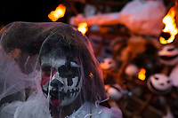 A Salvadoran boy, with skull face paint, performs an indigenous mythology character called La Llorona in the La Calabiuza parade at the Day of the Dead festivity in Tonacatepeque, El Salvador, 1 November 2016. The festival, known as La Calabiuza since the 90s of the last century, joins Salvador's pre-Hispanic heritage and the mythological figures (La Sihuanaba, El Cipitío, La Llorona etc.) collected from the whole Central American region, together with the catholic All Saints Day holiday and its tradition of honoring the dead relatives. Children and youths only, dressed up in scary costumes and carrying painted carts, march from the local cemetery to the downtown plaza where the party culminates with music, dance, drinking and eating pumpkin (Ayote) with honey.