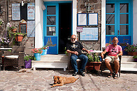 Locals at a cafe in the port of Molivos, Lesbos Island, Greece