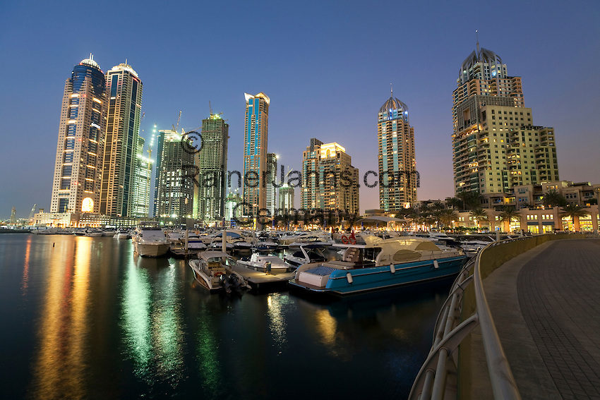 United Arab Emirates, Dubai: Dusk view over the marina with exclusive apartments and office blocks behind