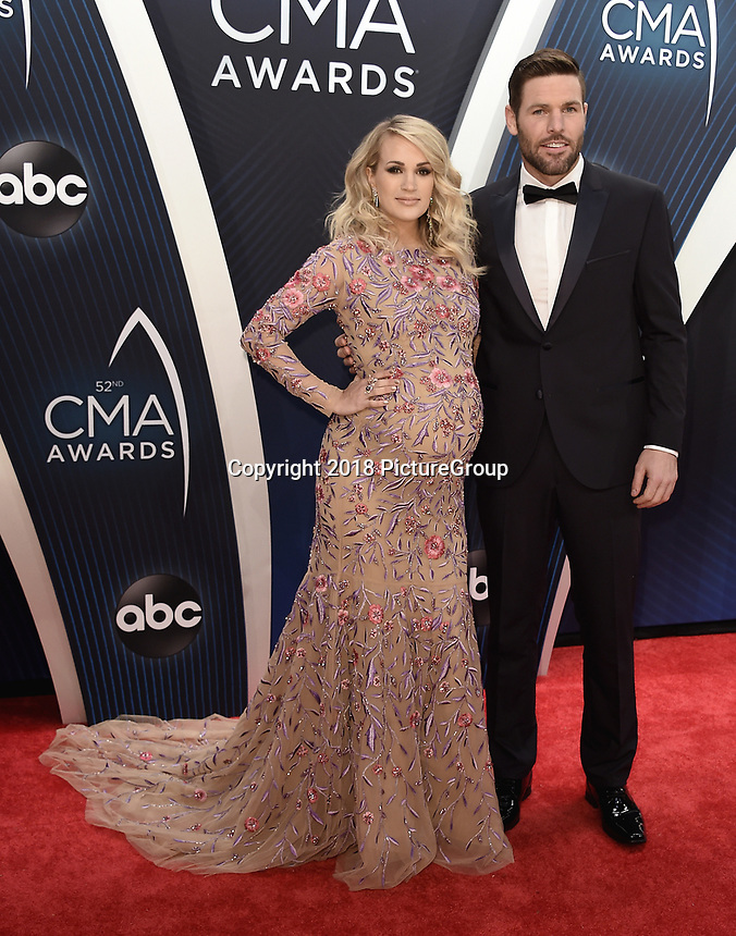 NASHVILLE, TN - NOVEMBER 14:  Carrie Underwood and Mike Fisher at the 52nd Annual CMA Awards at the Bridgetone Arena on November 14, 2018 iin Nashville, Tennessee. (Photo by Scott Kirkland/PictureGroup)