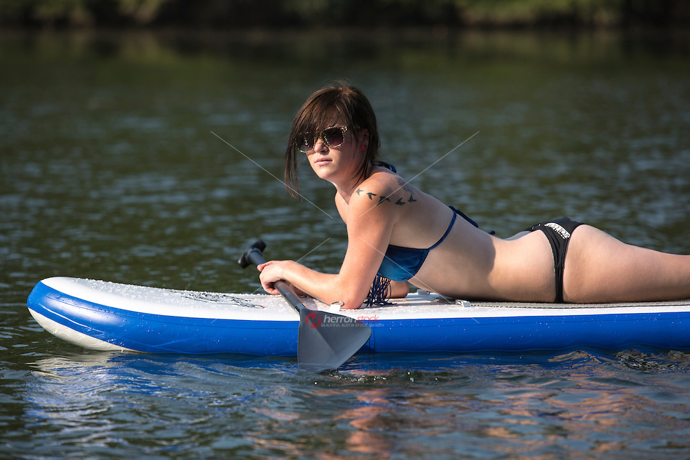 Stand up paddle surfing (SUP), stand up paddle boarding is an emerging global sport with a Austin, Texas heritage. Austin, Texas.