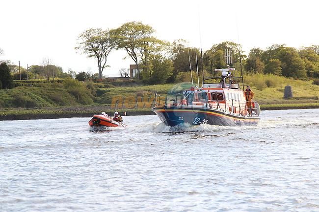 "MV Clipper Adventurer visiting Drogheda Port..She was flanked by Drogheda Port Company pilot Boats MV Boyne Havlock, MV Boyne Protector, Irish Coast Guard, D-Class from Drogheda Unit, RNLI MV Dorris Beasdale ""Clogherhead Lifeboat' as she left port..Picture Fran Caffrey www.newsfile.ie"