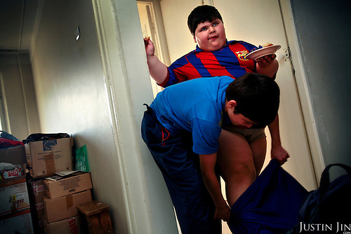 Dzhambulat Khotokhov, 6, one of the fattest boys in the world, gets dressed by his 14-year-old brother in their home town Terek, in southern Russia. Now 1.4 metres tall and weighing about 100 kg, Khotokhov has grabbed world attention as the biggest kid in the world since he was three. .Khotokhov lives with his mother Neyla and his brother, 14-year-old Mukha. .